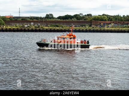 The Port of Tyne Pilot Boat Cruising up the River Tyne near Newcastle to Aid a Ship to Safely Enter Port Tyne and Wear England United Kingdom UK - Stock Photo