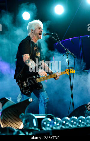 Eric Brittingham bassist for the Bret Michaels Band on stage at the Stagecoach Festival 2019 - Stock Photo