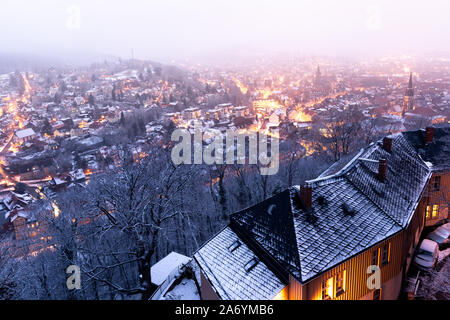 View from the castle terrace to the historical old town of Wernigerode in the night and snow. Harzmountains. - Stock Photo