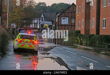 Severe flooding in Northwich Town, Chester way, River Weaver October 2019, Cheshire, England, UK - Police Cars Close flooded area Stock Photo
