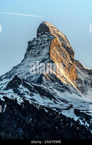 East and north faces of the Matterhorn during sunrise in Zermatt, Switzerland during spring time. - Stock Photo