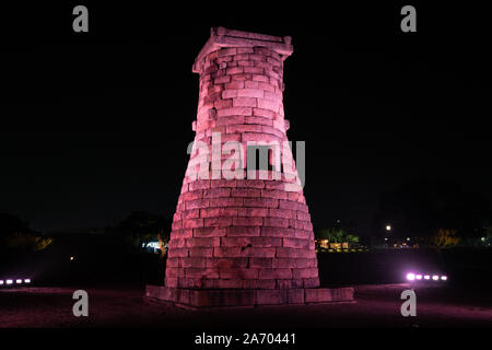 Scenic view of illuminated Cheomseongdae an ancient astronomical observatory at night in the Wolseong Belt Gyeongju South Korea - Stock Photo