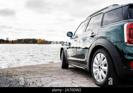 Mini Countryman electric car charging by the beach - Stock Photo