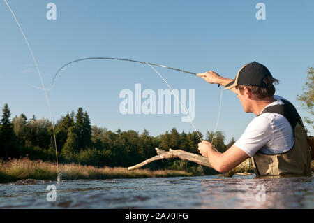 Flyfisher in action - Stock Photo