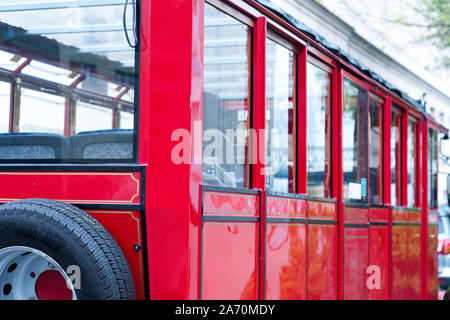detail of a vintage empty  red tram. old style transport. turistic bus - Stock Photo