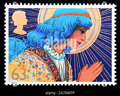 Postage stamp. Great Britain. Queen Elizabeth II. Christmas 1998. Angels. Angel praying. 63p. - Stock Photo