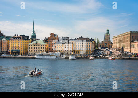 Stockholm Old Town, view in summer across Strommen lake towards the Stockholm old town (Gamla Stan) waterfront area and skyline, Sweden. - Stock Photo