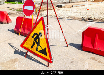 Road works traffic sign at the city street, stop sign. Road under construction - Stock Photo