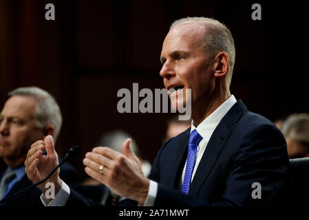 (191029) -- WASHINGTON, Oct. 29, 2019 (Xinhua) -- Boeing CEO Dennis Muilenburg testifies before U.S. Senate Committee on Commerce, Science and Transportation on Capitol Hill in Washington D.C., the United States, on Oct. 29, 2019. Boeing CEO Dennis Muilenburg acknowledged mistakes as he testified before the U.S. Congress for the first time since two deadly air crashes of its 737 Max planes that killed 346 people, but he deflected tough questions such as why the company withheld details about its flawed new automated system. (Photo by Ting Shen/Xinhua) - Stock Photo