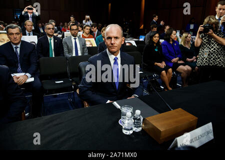 (191029) -- WASHINGTON, Oct. 29, 2019 (Xinhua) -- Boeing CEO Dennis Muilenburg (C) arrives to testify before U.S. Senate Committee on Commerce, Science and Transportation on Capitol Hill in Washington D.C., the United States, on Oct. 29, 2019. Boeing CEO Dennis Muilenburg acknowledged mistakes as he testified before the U.S. Congress for the first time since two deadly air crashes of its 737 Max planes that killed 346 people, but he deflected tough questions such as why the company withheld details about its flawed new automated system. (Photo by Ting Shen/Xinhua) - Stock Photo
