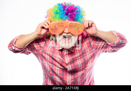 Man senior bearded cheerful person wear colorful wig and sunglasses. Elderly clown. Having fun. Funny lifestyle. Fun and entertainment. Comic grandfather concept. Nice joke. Grandpa always fun. - Stock Photo