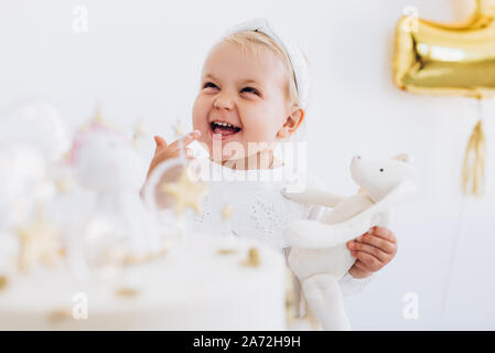 The child eats cake with appetite. Birthday baby. - Stock Photo