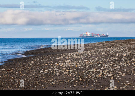 A large ship in the Strait of Juan De Fuca seen from Dungeness Recreation Area, Washington. - Stock Photo