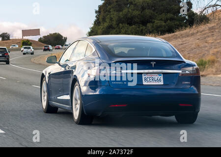 October 19, 2019 Palo Alto / CA / USA - The new Model 3 Tesla driving on the freeway in San Francisco bay area - Stock Photo