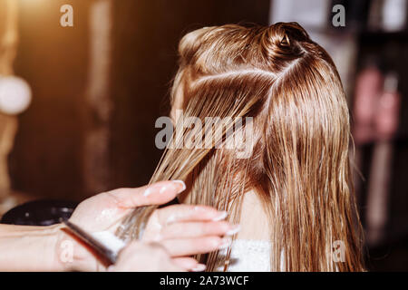 Keratin Restoration Hair Care Concept Beautician Apply Balm And Conditioner To The Hair Of Woman After Haircut Close Up Of Female Hairdresser S Han Stock Photo Alamy