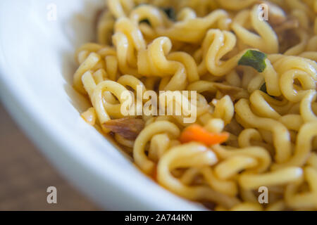 Close up photography of a bowl of instant ramen noodles - Stock Photo