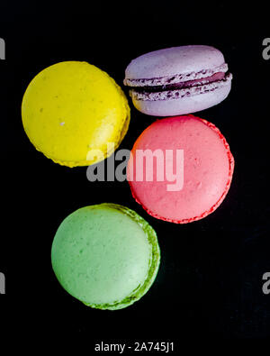 Macaroons cookies on a dark canvas background. - Stock Photo