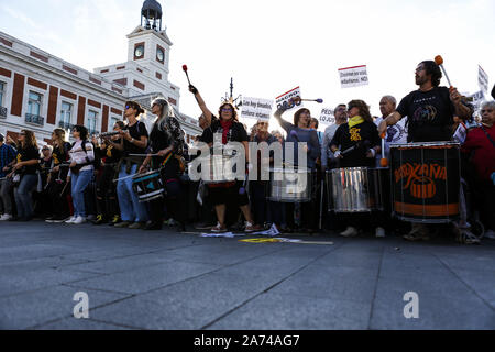 Madrid, Spain. 15th Oct, 2019. Protesters playing drums during the demonstration.Thousands of people gathered at Puerta del Sol to protest against precariousness and low pensions for elder people. Marches from Bilbao (northern Spain) and Rota (southern Spain) met at the country's capital to protest in front of Spanish Parliament. Credit: Guillermo Santos/SOPA Images/ZUMA Wire/Alamy Live News - Stock Photo
