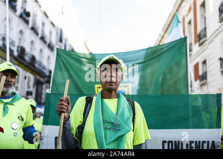 Madrid, Spain. 15th Oct, 2019. An old man heading the march during the demonstration.Thousands of people gathered at Puerta del Sol to protest against precariousness and low pensions for elder people. Marches from Bilbao (northern Spain) and Rota (southern Spain) met at the country's capital to protest in front of Spanish Parliament. Credit: Guillermo Santos/SOPA Images/ZUMA Wire/Alamy Live News - Stock Photo