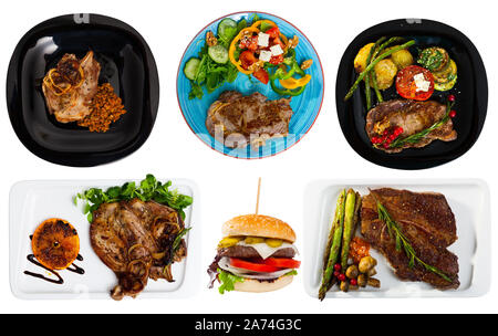 Set of assorted pork and beef dishes isolated on white - Stock Photo