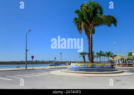 09.16.2019. Algarve, Portugal. Palm trees at Santa Luzia against the Ria Formosa. - Stock Photo
