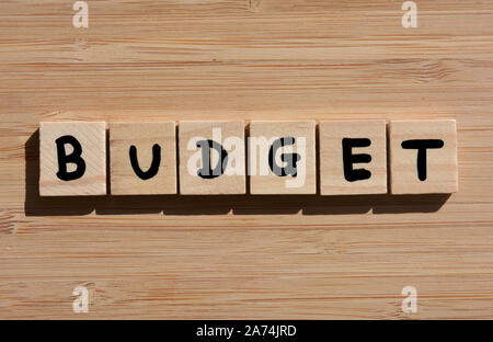 Budget. word in 3d wooden alphabet letters on a bamboo wood background - Stock Photo