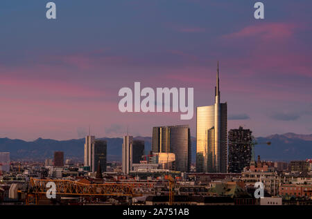 Milan (Italy) skyline at sunset with modern skyscrapers in Porta Nuova business district. - Stock Photo