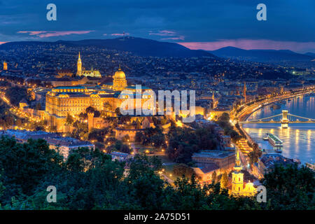 Hungary, Budapest, Castle District, Royal Palace and Chain Bridge over River Danube - Stock Photo
