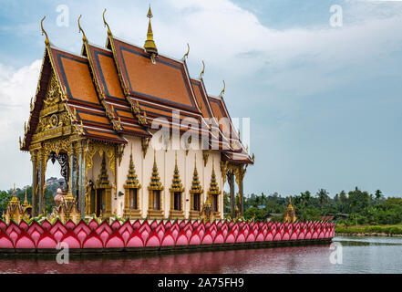 Ko Samui Island, Thailand - March 18, 2019: Wat Laem Suwannaram Chinese Buddhist Temple. Wat Plai Laem shrine on its platform upon pink lotus upon lak - Stock Photo