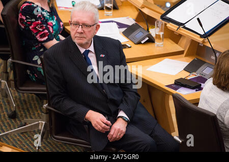 Edinburgh, 30 October 2019. Pictured: Michael Russell MSP.  Scenes from the chamber in the Scottish Parliament in Edinburgh.  Ministerial Statement: Impact of the Proposed New EU Exit Deal on Scotland. Credit: Colin Fisher/Alamy Live News - Stock Photo
