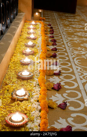 A STILL LIFE OF DIWALI  FESTIVAL DECORATION IOUTSIDE THE MAIN DOOR OF A HOUSE IN MUMBAI INDIA SHOWING RANGOLI, DIYAS, , FLOWERS, - Stock Photo