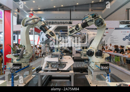 Chongqing,China-August,29th 2019:Robot arm assemble car display in Smart China expo. China is developing its technology in robot industry . - Stock Photo