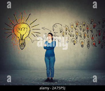 Casual woman, confident face expression, keeps arms crossed, thinking and gathering new ideas to create a final plan. Ingenious girl, creative genius