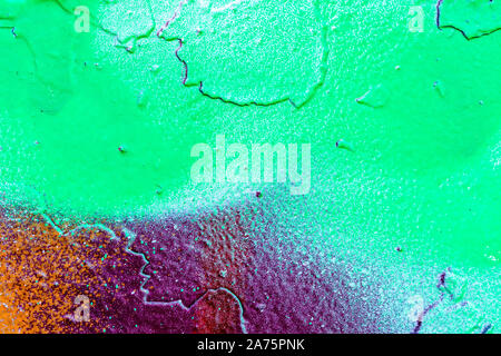 Fragment of colored graffiti painted on a wall. Abstract background for design. - Stock Photo