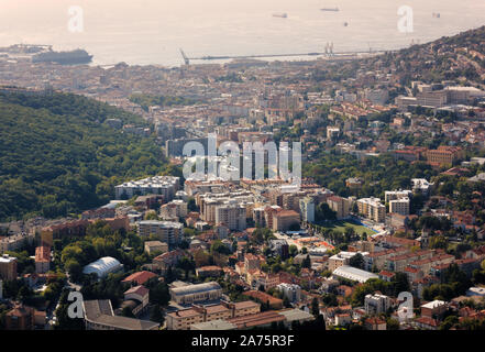 Cityscape of Trieste, Italy, with the university on the right and the seaport in the background - Stock Photo