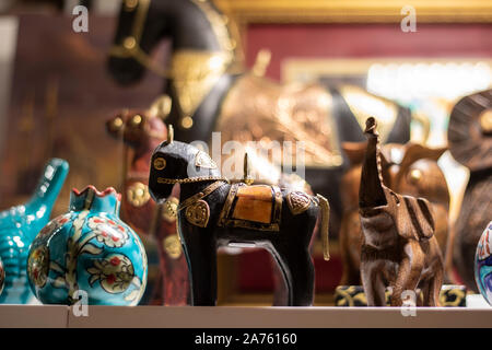 Close-up of poppy horse in souvenir store. Porcelain box on the left. Wooden elephant on the right. - Stock Photo