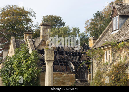 Burnt out stone cottage roof in the Cotswolds - Stock Photo