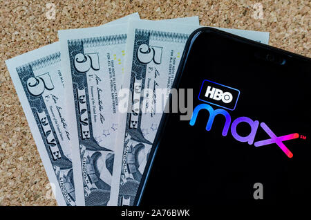 HBO max logo on a smartphone and 15 US dollars next to it, which is monthly fee for a new video streaming service. - Stock Photo