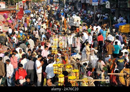 Mumbai; Maharashtra; India, Southeast Asia - Oct. 25; 2011: People shopping for Diwali Festival Crowd on road at Dadar Market Near railway station. - Stock Photo