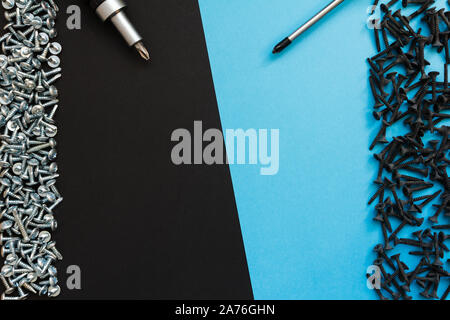 Flat Lay Composition With Different Construction Tools on Black Background. Top View of Checklist and Working Tools, Wrench, Screwdriver, Plier. - Stock Photo