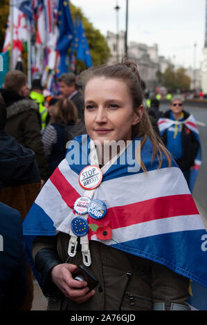 Female anti-Brexit campaigner outside the Houses of Parliament in London, UK - Stock Photo