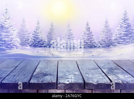 Beautiful festive Christmas snowy background with wooden table. Morning winter landscape with snowy christmas trees. - Stock Photo