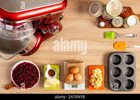 Ingredients for baking muffins on wooden table - Stock Photo