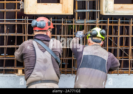 Construction workers bending - wiring concrete steel bars outdoors in Nuuk. - Stock Photo
