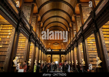 The historic Long Room of the Old Library, in Trinity College, Dublin, Ireland - Stock Photo