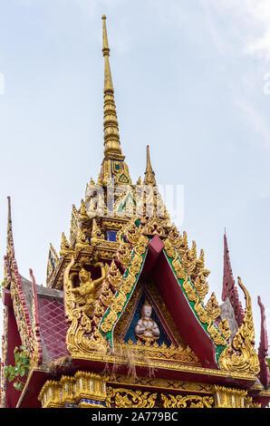 Ko Samui Island, Thailand - March 18, 2019: Wat Laem Suwannaram Chinese Buddhist Temple. Tower and spire of small golden shrine with statue, loudspeak - Stock Photo