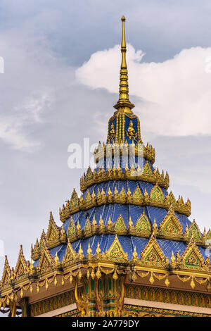 Ko Samui Island, Thailand - March 18, 2019: Wat Laem Suwannaram Chinese Buddhist Temple. Closeup of gold and blue sprang, spire on top of sanctuary ag - Stock Photo