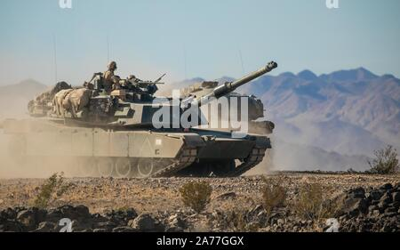 U.S. Marines with 1st Tank Battalion, 1st Marine Division participate in a field exercise (FEX) at Marine Corps Air Ground Combat Center Twentynine Palms, California, Oct. 22, 2019. The FEX was conducted in preparation for Exercise Steel Knight 2020. (U.S. Marine Corps photo by Sgt. Miguel A. Rosales) - Stock Photo