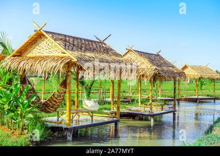 The resting huts constructed from bamboo and thatched roofs for relaxing in the rice fields. - Stock Photo