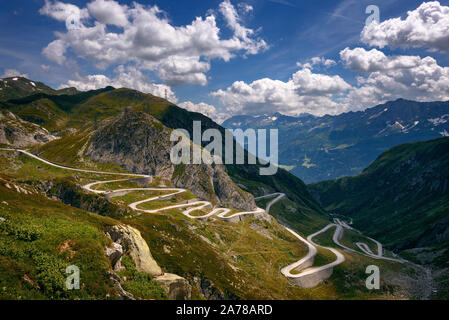 Aerial view of an old road going through the St. Gotthard pass in the Swiss Alps - Stock Photo